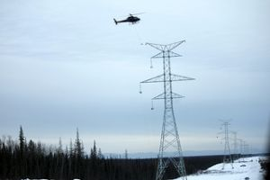 Helicopter stringing electrical line