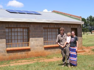 Fred, Amy, Nyana with Solar Panels