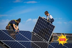 ReVision employees installing solar panels on the roof of Colby Sawyer
