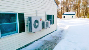 Image of an air source heat pump at work in the winter
