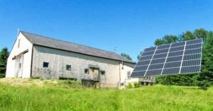 Solar tracker by barn in Exeter New Hampshire