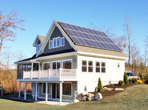 An example of net-zero construction, this is an image of a solar home in Sweden, Maine with solar panels by ReVision Energy