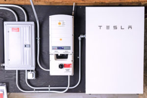 Image of a Tesla Powerwall 2 storing solar electricity that has been installed at customer's home in Falmouth, ME