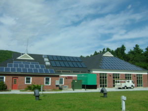 12kw grid tied solar electric system installed with 16 flat plate solar hot water collectors on the Aqua Maine water treatment plant in Rockland Maine