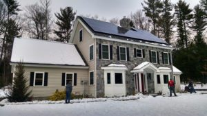A solar paneled home producing electricity on a cold winter day.