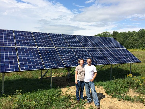 Solar Homeowners Lauren and Nate Zike in front of their 5.83kw solar electric array. Their solar array will meet close to 100% of their energy needs, allowing them to control their energy costs, all while helping reduce strain on the local energy grid and reducing pollution from fossil fuel sources.