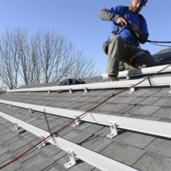 Zach Good of ReVision Energy prepares a roof for solar panels at a home on Overlook Lane in Cape Elizabeth in 2015. Shawn Patrick Ouellette/Potland Press Herald Staff Photographer