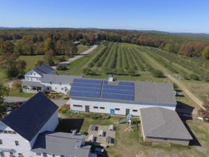 Drone image of solar panels by ReVision Energy at McDougal's Orchard