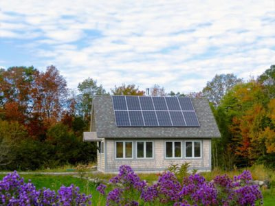 The solar-powered office of David Foley and Judy Berk is designed for passive solar gain. The twelve solar panels on the roof, installed by ReVision Energy, provide enough electricity to offset 'plug loads' for both the office and Foley-Berk's nearby house. Photo: Judy Berk