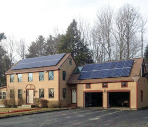 An image of a home in Maine taking advantage of the economics of solar with panels
