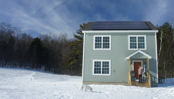 The new building sits facing perfect solar-south and has 21 solar panels which will produce around 7,000 kilowatt-hours of clean electricity each year, saving Eliza and Marco money, reducing carbon pollution into the atmosphere, and reducing the cost that all Mainers pay to maintain an outdated electric grid.