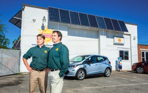 Fortunat Mueller, left, and Phil Coupe, co-founders of ReVision Energy, in Portland. A 2017 Chevrolet Bolt, left, and a 2017 Chrysler Pacifica Hybrid charge in the background. They say B Corp status helps attract and retain employees. Photo Courtesy Mainebiz.