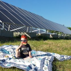 A photo from a picnic we hosted at the Belfast Land Fill solar project last June. This project was the first solar array installed on a capped landfill in the State of Maine.