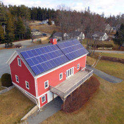 A drone shot of a solar electric array at the Causeway Club on Mount Desert Island.