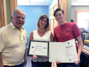 Brigadier General (Ret) John G. Pappas (left) presents the Patriotic Award to ReVision Energy NH-Branch Manager Heather Fournier (center), with ReVision Energy Renewable Energy Advisor Kayla Wernig (right).