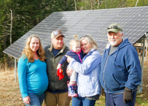 Koutelis family with ground mounted solar array