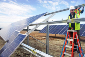 ReVision worker-owners installing photovoltaic modules for a new micro-grid project at the redeveloped Brunswick Naval Air Station
