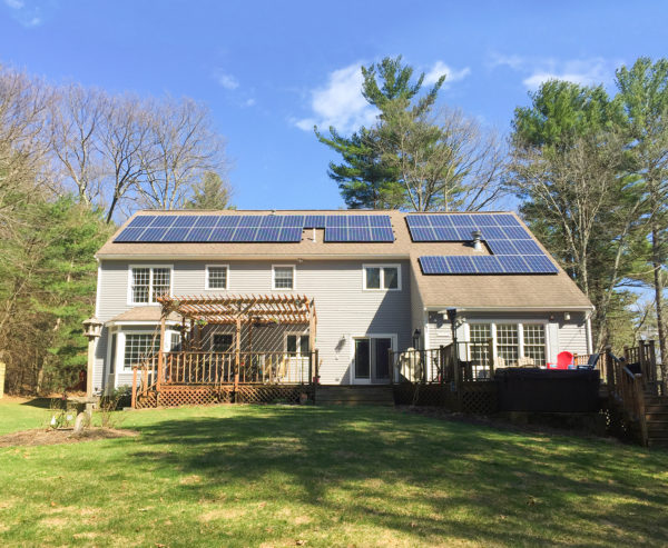 A residential solar power system on a roof in Massachusetts