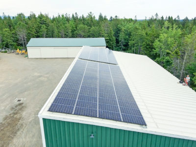 Rooftop solar array at Classic Boat Shop in Bernard, ME