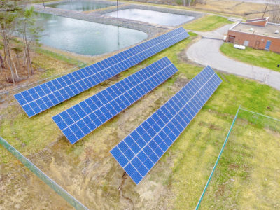 Ground mount solar array at the Town of Newfields Water & Sewer Department District Plants Grounds in NH.