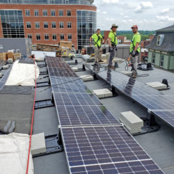 ReVision Energy crew installing solar on Bank of NH Stage Rooftop in Concord, NH