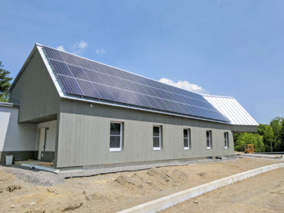 Rooftop solar array on Passive House-standard Cornerspring Montessori School in Belfast, ME