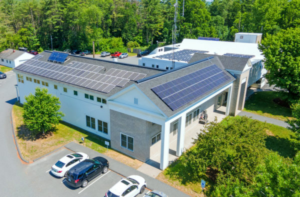 Solar panels cover three rooftops at the Hanover, NH Safety Complex