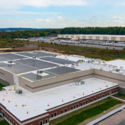 An aerial view of Bellance Beverage's 3,000+ panel rooftop solar array.